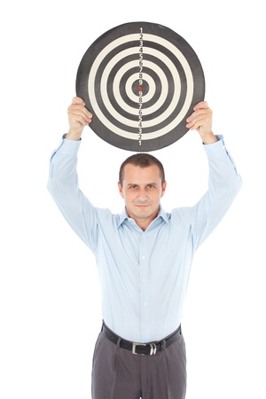 Young businessman holding a target above his head, isolated on white background photo