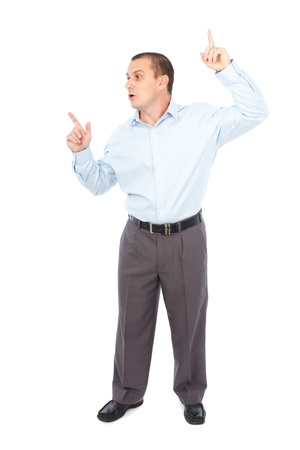 Young businessman explaining or presenting a product, pointing at copyspace photo