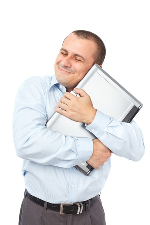Happy businessman holding his dear laptop, isolated on white background