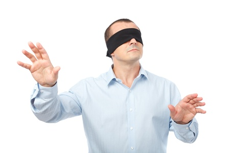 blindfolded: Businessman blindfolded stretching his arms out, isolated on white background Stock Photo