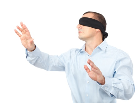 Businessman blindfolded stretching his arms out, isolated on white background Stock Photo
