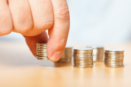 collect: Businessman reaching for pennies, financial crisis concept