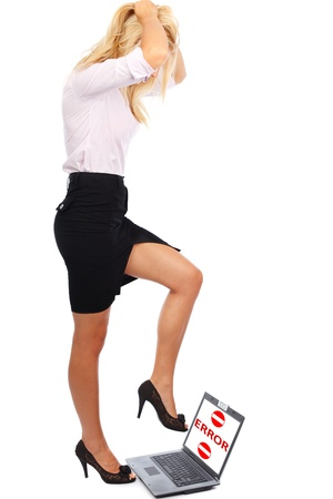 trample: Businesswoman trample laptop with error message on screen, easily replaceable with your own text Stock Photo
