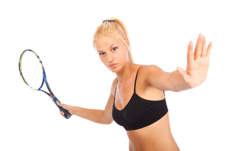 Young woman playing tennis isolated on white background Stock Photo - 10628524
