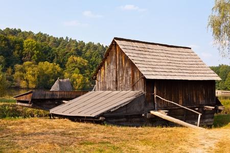 watermill: Antiguo molino de agua r�plica de madera en un prado