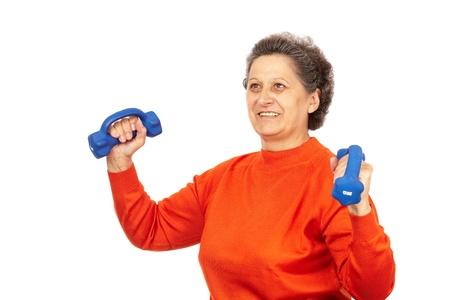 one senior adult woman: Mujer senior activa con pesas de capacitaci�n, aislado en blanco