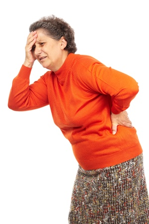 elderly pain: Senior woman with strong backache isolated on white background Stock Photo