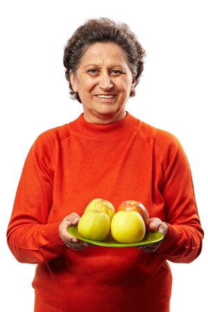 Senior woman with apples on a plate, healthy eating concept photo