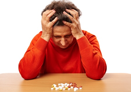 Senior woman worried about drug abuse, having to take too many pills photo