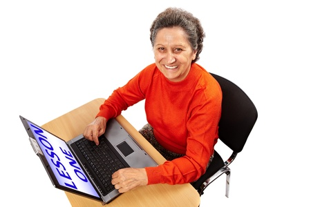 use computer: Senior woman learning to use the computer, isolated on white background Stock Photo