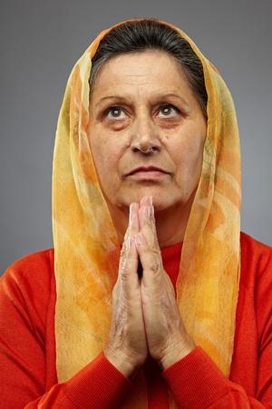 Portrait of a senior caucasian woman praying Stock Photo - 10930088
