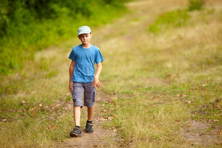 Full length portrait of a boy walking outdoor in a forest Stock Photo - 11029018