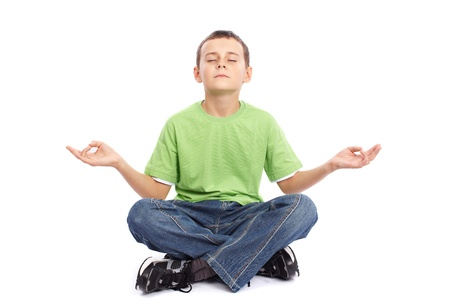 10 years old schoolboy meditating isolated on white Stock Photo - 11029004