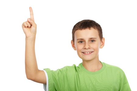 Cute kid pointing up, isolated on white background photo