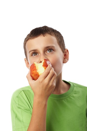Kid with red apple isolated on white background photo