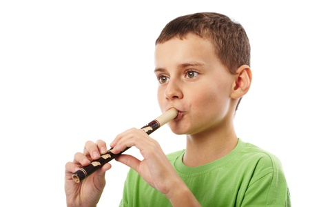 Boy playing the pipe, isolated on white background Stock Photo