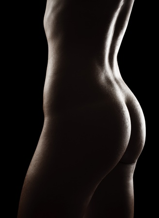Nude young woman torso isolated on black background photo
