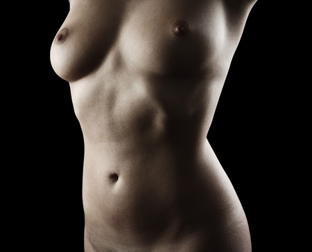 Nude body of a young woman isolated on black background photo