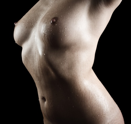 Nude body of a young woman isolated on black background Stock Photo - 11272000
