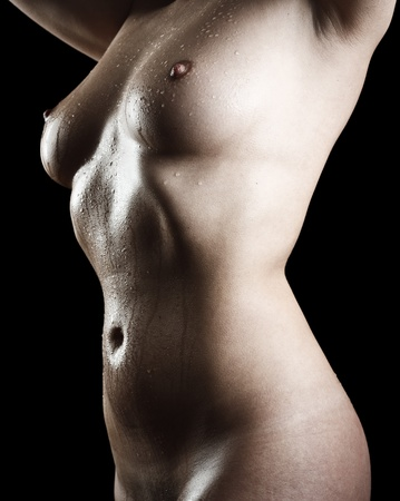 Nude body of a young woman isolated on black background Stock Photo - 11272083