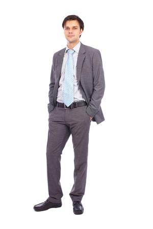 Portrait en pied d'un jeune homme d'affaires isolé sur fond blanc