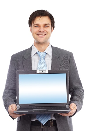 Young businessman holding laptop with copyspace on the screen photo