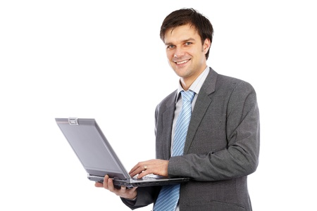 Young businessman holding laptop isolated on white background photo