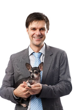 Young businessman holding his chihuahua dog pet photo