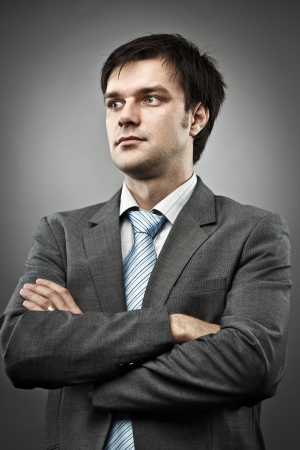 Studio portrait of a young businessman, with his arms folded Stock Photo - 20237029
