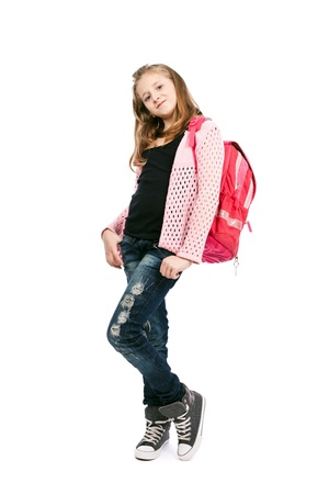 Full length portrait of a schoolgirl with backpack isolated on white background photo