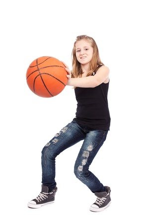 Full length portrait of a girl playing basketball isolated on white background
