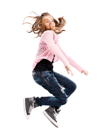 Cute girl jumping for joy isolated on white background photo
