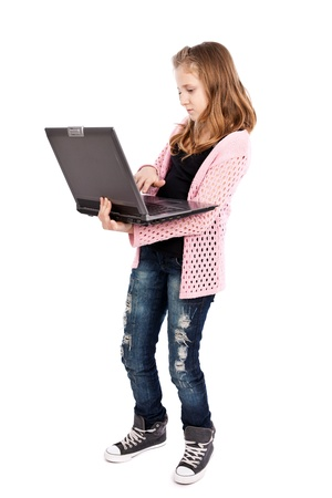 Cute girl holding a laptop isolated on white background photo