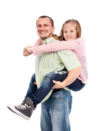 Father giving his daughter a piggyback ride, isolated on white background photo