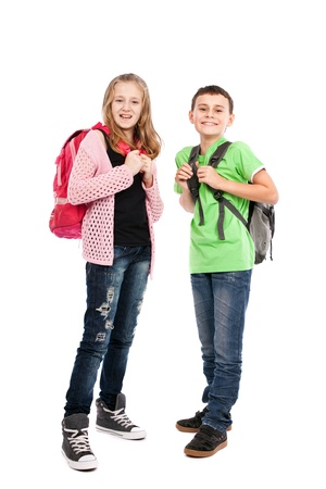 Two school children with backpack isolated on white