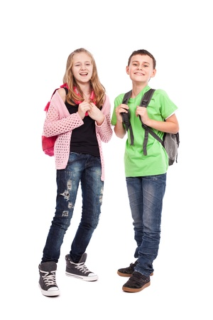 School children, boy and girl, with backpacks isolated on white photo