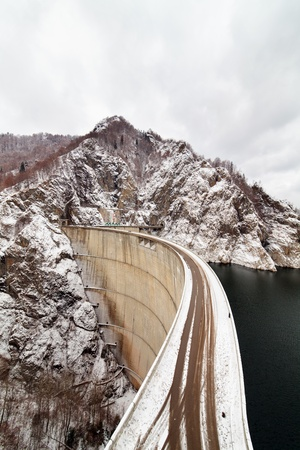Dam lake Vidraru in the winter, in Romanian mountains photo