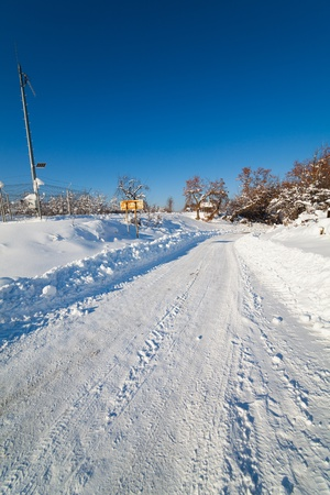 Landscape with a snowy road in countryside Stock Photo - 12223081