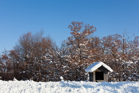 Landscape with wooden shack in the snow, under blue sky Stock Photo - 12223129