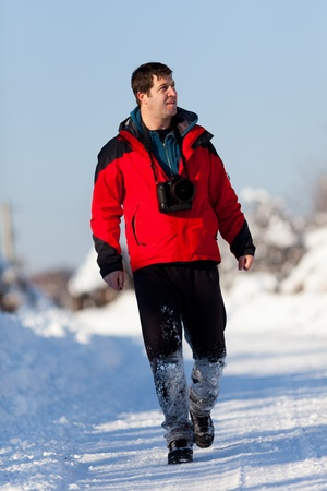 Caucasian tourist with camera in a winter day Stock Photo - 12223071