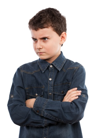 scowl: Closeup portrait of an angry boy with his arms folded Stock Photo