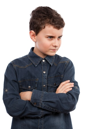 outraged: Closeup portrait of an angry boy with his arms folded Stock Photo