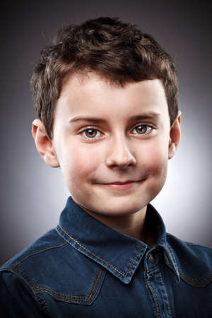 Studio closeup portrait of a smiling boy photo