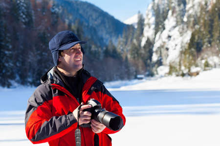 Portrait of a professional nature photographer outdoor in the winter landscape Stock Photo - 12521602