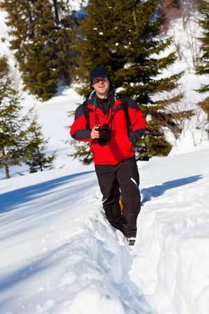 Portrait of a professional nature photographer outdoor in the winter landscape photo