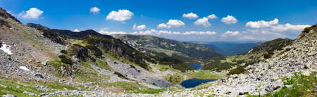 Panoramic landscape of lake Calcescu valley in Parang mountains, Romania photo