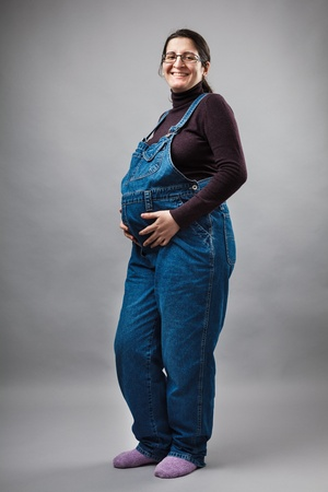 Studio portrait of a young pregnant woman Stock Photo - 12845856