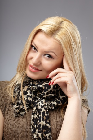 Studio closeup portrait of a fashionable blond woman Stock Photo - 12957505