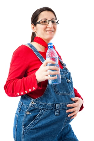 Preganant woman with a bottle of water isolated on white background photo