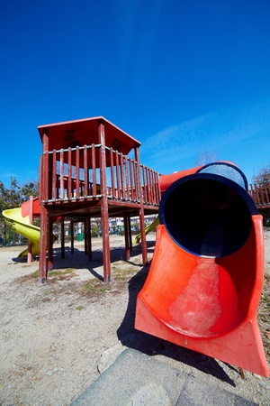 Worn playground in the city, on a sunny day photo
